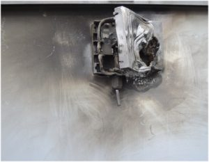 Example of a junction box burnt following the appearance of an electric arc