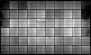 Example of a module with a PID defect (dark spots at the edge of the modules) appearing when there is a very important difference of potential between the frame and the cells. This defect leads to very significant production cuts
